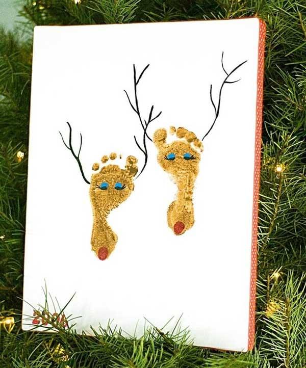 quadro de natal feito com os pés da criança
